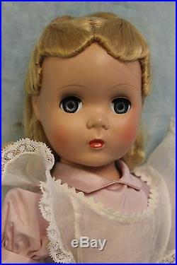 17 Madame Alexander Alice In Wonderland tagged hard plastic Maggie Face c. 1949